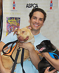"""Will Swenson in """"Priscilla Queen of the Desert"""" - Broadway Barks Lucky 13th Annual Adopt-a-thon - A """"Pawpular"""" Star-studded dog and cat adopt-a-thon on July 9, 2011 in Shubert Alley, New York City, New York with Bernadette Peters and Mary Tyler Moore as hosts.  (Photo by Sue Coflin/Max Photos)"""