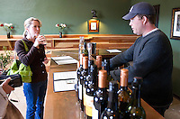 1/2/2011-  Todd Bostock, of Dos Cabezas Wineworks, talked with visitors in his tasting room in Sonoita, Arizona. (Photo by Pat Shannahan)