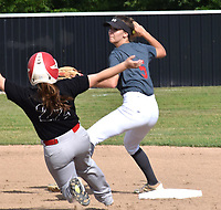 RICK PECK/SPECIAL TO MCDONALD COUNTY PRESS McDonald county's Whitney Kinser gets forced out at second base during the Lady Mustangs' 14-4 loss on June 26 to Nevada at MCHS. McDonald County will have a camp in July before practices for the fall season begin Aug. 12.