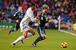 Real Madrid's Danilo Luiz Da Silva and Real Sociedad's Juanmi Jimenez during La Liga match between Real Madrid and Real Sociedad at Santiago Bernabeu Stadium in Madrid, Spain. January 29, 2017. (ALTERPHOTOS/BorjaB.Hojas)