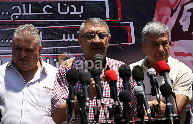 Palestinians take part during a protest to demanding right of patients to travel for treatment, in Gaza city on June 19, 2017. Photo by Mohammed Asad