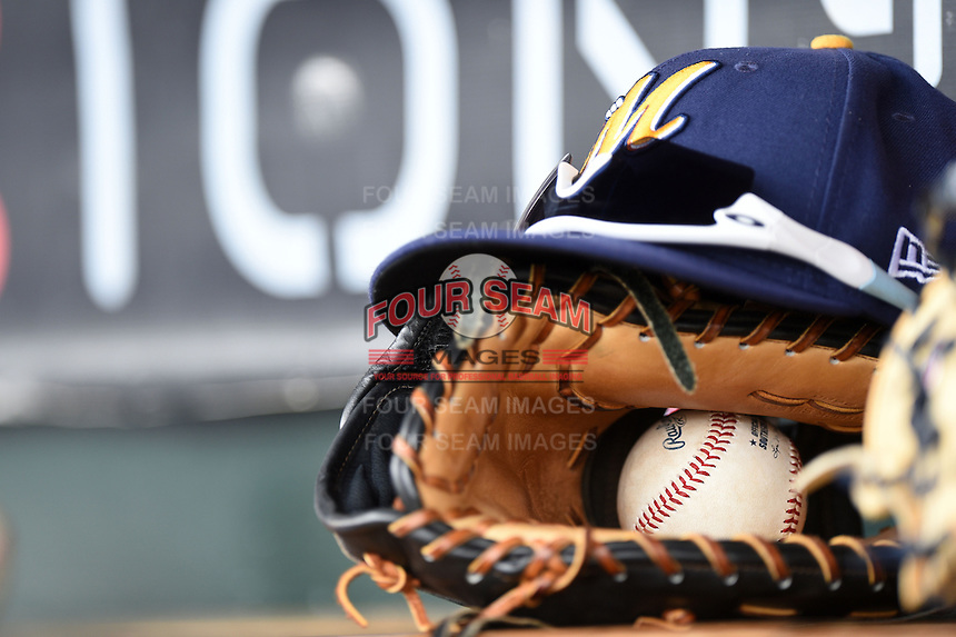 Montgomery Biscuits hat, glove, Oakley sunglasses and Southern League baseball in the dugout during a game against the Mississippi Braves on April 22, 2014 at Riverwalk Stadium in Montgomery, Alabama.  Mississippi defeated Montgomery 6-2.  (Mike Janes/Four Seam Images)