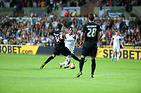 Thursday  03 October  2013  Pictured:Jonathan de Guzman tries to get the ball past Roberto Rodriguez and Ermir Lenjani of St.Gallen<br /> Re:UEFA Europa League, Swansea City FC vs FC St.Gallen,  at the Liberty Staduim Swansea