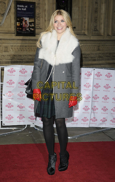 Holly Willoughby.The 'We Are Most Amused' Prince's Trust Comedy Gala, Royal Albert Hall, Kensington Gore, London, England..November 28th, 2012.full length fur coat grey gray white collar wrap red gloves black tights bag purse ankle boots .CAP/CAN.©Can Nguyen/Capital Pictures.