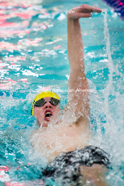 WATERBURY, CT- 4 January 2015-010416EC10-   Holy Cross' Sean Harnish competes in the 100 Backstroke event against Cheshire at Kennedy High School Monday night. Erin Covey Republican-American