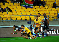 Odwa Ndungane scores to give the Sharks a late lead during the Super Rugby match between the Hurricanes and Sharks at Westpac Stadium, Wellington, New Zealand on Saturday, 9 May 2015. Photo: Dave Lintott / lintottphoto.co.nz