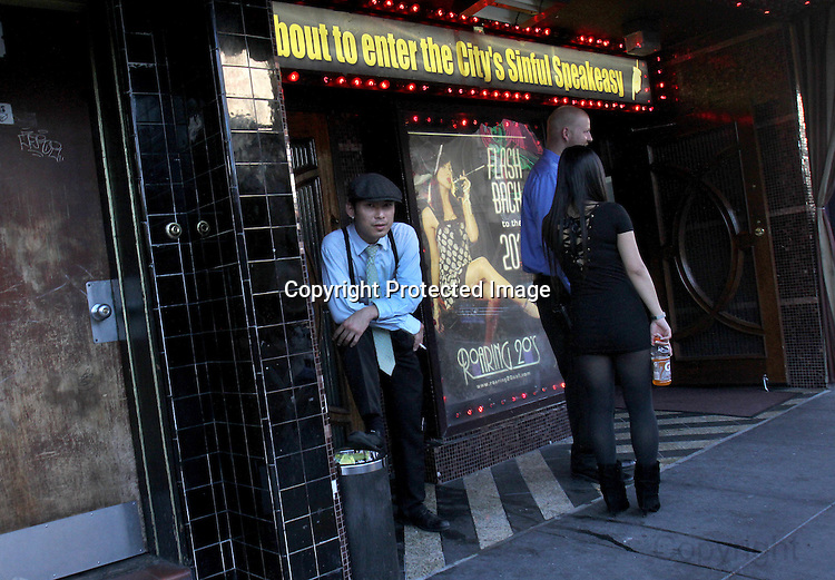 A man poses for a portrait in front of a Broadway establishment in Northbeach near Grant Street in San Francisco, CA..