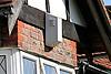 Burglar alarm on house in suburban residential street in Surrey; UK