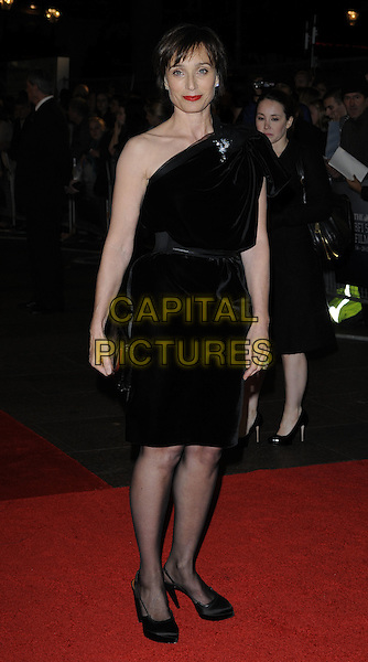 """KRISTIN SCOTT THOMAS.The closing gala premiere of """"Nowhere Boy"""" during the The Times BFI London Film Festival, Odeon Leicester Square, London, England..October 29th, 2009 .LFF full length dress black brooch velvet clutch bag .CAP/CAN.©Can Nguyen/Capital Pictures."""