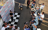 Apr 17, 2009; Avondale, AZ, USA; NASCAR Sprint Cup Series driver Mark Martin poses for photographers after winning the pole position for the Subway Fresh Fit 500 at Phoenix International Raceway. Mandatory Credit: Mark J. Rebilas-