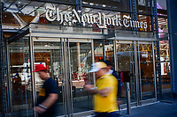 "NEW YORK, USA - October 14: People walk along 8av as the New York Times building is seen at the background on October 14, 2019 in New York, USA. NY Times on Sunday evening, published a story titled, ""Macabre Video of Fake Trump Shooting Media and Critics Is Shown at His Resort."" The video showed the president as a mass shooter where he is executing media and his political opponents inside church. It was dysplayed at a pro Trump conference in Miami. NY Times is an American newspaper based in New York City with worldwide influence,  the paper has won 127 Pulitzer Prizes,  being ranked 18th in the world by circulation. (Photo by Eduardo MunozAlvarez/VIEWpress)"