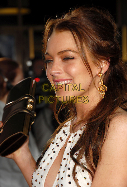 """LINDSAY LOHAN.The Twentieth Century Fox Premiere of """"Just My Luck"""" held at The Mann National Theater in Westwood, California, USA..May 9th, 2006.Ref: DVS.headshot portrait studs earrings clutch purse.www.capitalpictures.com.sales@capitalpictures.com.Supplied By Capital PIctures"""