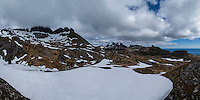 Panoramic view of early summer conditions at Støvla mountain peak, Moskenesøy, Lofoten Islands, Norway