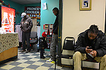 Customers are seen waiting on hot fried chicken orders at Prince's Hot Chicken in Nashville, Tennessee on January 3, 2012.