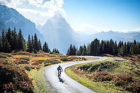 Road biking on the Swiss Alps classic Grosse Scheidegg, a pass connecting Grindelwald with Meiringen, in the Berner Oberland, Switzerland. In the background is the Eiger.