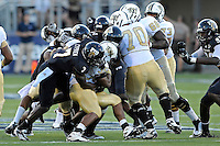 17 September 2011:  FIU safety Jonathan Cyprien (7) and other defenders tackle UCF running back Ronnie Weaver (35) in the first quarter as the FIU Golden Panthers defeated the University of Central Florida Golden Knights, 17-10, at FIU Stadium in Miami, Florida.