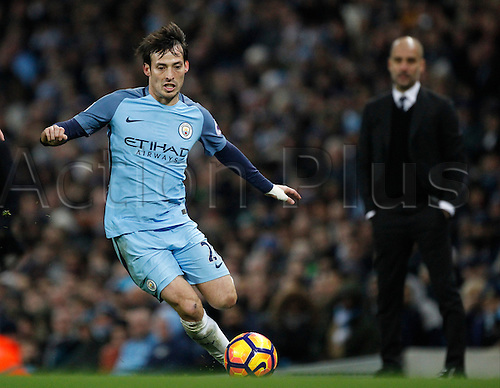21st January 2017, Etihad Stadium, Manchester, Lancashire, England; EPL Premiership football Manchester City versus Tottenham Hotspur; David Silva of Manchester City on the ball as manager Pep Guardiola looks on