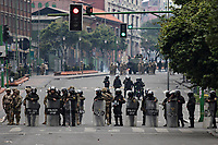 La Paz, Bolivia<br /> Wednesday November 13, 2019<br /> Anti riot Police and members of the military look at people protesting near the Gobernment Palace in the Capital city of La Paz.  After the October 20 presidential elections and resignation of President Evo Morales, there is a lot of protests in many regions of Bolivia.