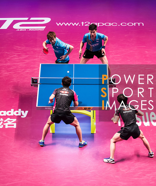 Masataka Morizono & Yuy Oshima (JPN) vs Youngsik Jeoung & Sangsu Lee (KOR) at the Men's Doubles Final match during the Seamaster Qatar 2016 ITTF World Tour Grand Finals at the Ali Bin Hamad Al Attiya Arena on 11 December 2016, in Doha, Qatar. Photo by Victor Fraile / Power Sport Images