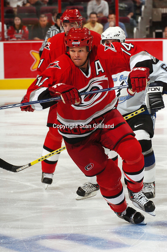 Carolina Hurricanes' Kevyn Adams tries to gain speed chasing a puck during a game with the Tampa Bay Lightning Thursday, Sep. 22, 2005 in Raleigh, NC. Carolina won 5-2.