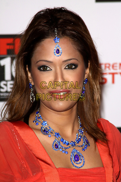 TASMIN LUCIA KHAN.The FHM 100 Sexiest Women for 2011 party, One Marylebone Rd., London, England..May 4th, 2011.headshot portrait orange red pink orange blue necklace earrings headband hair.CAP/AH.©Adam Houghton/Capital Pictures.