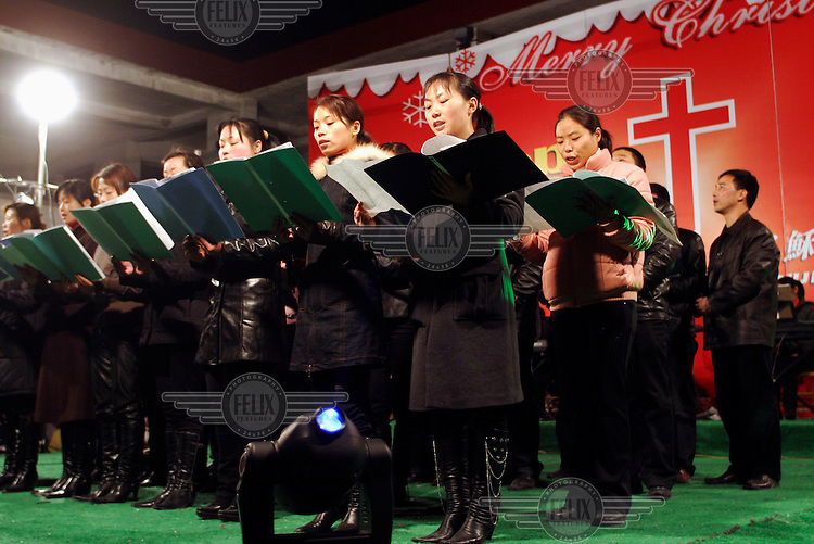 A youth choir sings during a Christmas celebration party. Organised by unauthorized house churches in the surrounding areas without official approval, the gathering had attracted over 5,000 people, including non-Christians. Christianity has regained enormous popularity in some parts of China after being silent for decades during the cultural revolution, however some believers in the faith do not want a government regulated religion and organise their own underground house churches.