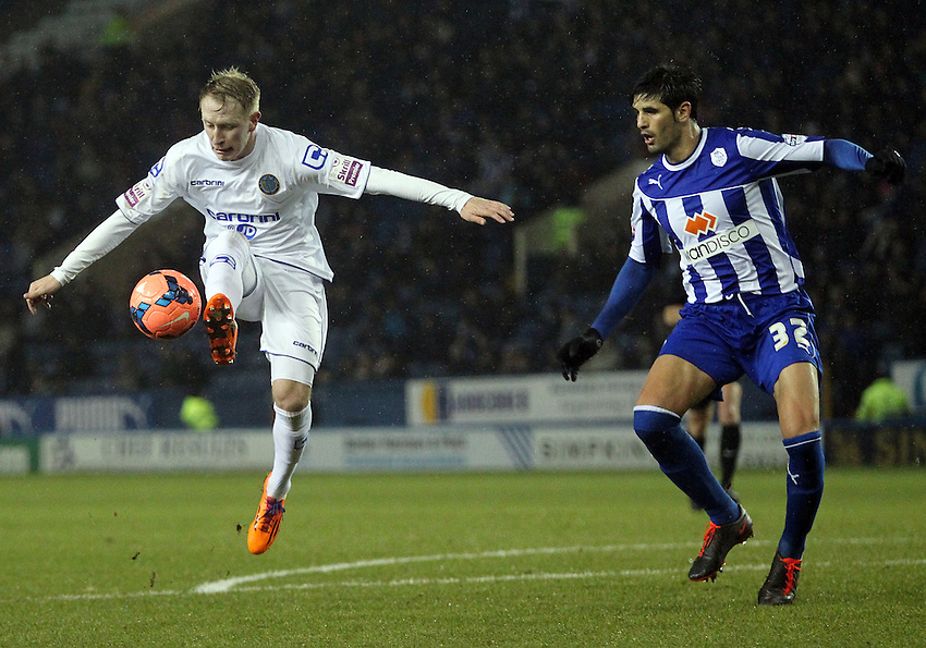 Macclesfield Town's Scott Boden controls the ball under pressure from Sheffield Wednesday's Miguel Angel Llera<br /> <br /> Photo by Rich Linley/CameraSport<br /> <br /> Football - FA Challenge Cup Third Round replay - Sheffield Wednesday v Macclesfield Town - Tuesday 14th January 2014 - Hillsborough - Sheffield<br /> <br />  &copy; CameraSport - 43 Linden Ave. Countesthorpe. Leicester. England. LE8 5PG - Tel: +44 (0) 116 277 4147 - admin@camerasport.com - www.camerasport.com