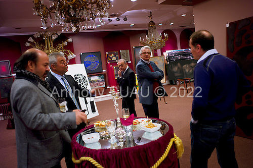 Istanbul, Turkey<br /> March 9, 2011<br /> <br /> Potential clients attend an viewing of art work for an auction to be held next month.