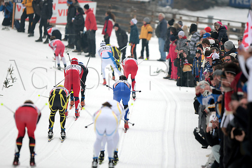 08.01.2011.  TOUR DE SKI - STAGE 7. Skiers during the 20 km classic mass start in Val Di Fiemme, Italy.