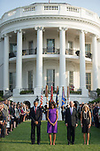 United States President Barack Obama (L), First Lady Michelle Obama, Vice President Joe Biden, Dr. Jill Biden and White House staff observe a moment of silence for the 12 anniversary of the 9/11 terrorist attacks, at the White House on September 11, 2013 in Washington, D.C. UPI/Kevin Dietsch<br /> Credit: Kevin Dietsch / Pool via CNP