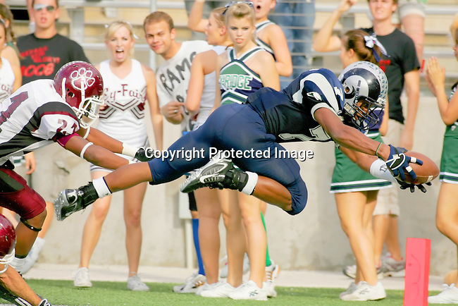 Cy Ridge High School running back Kyle Hamilton scores in a division match-up with Cy Fair High School that Cy Ridge won 42-21.