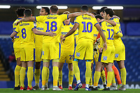 AFC Wimbledon players get ready for their huddle ahead of kick-off during Chelsea Under-21 vs AFC Wimbledon, Checkatrade Trophy Football at Stamford Bridge on 4th December 2018
