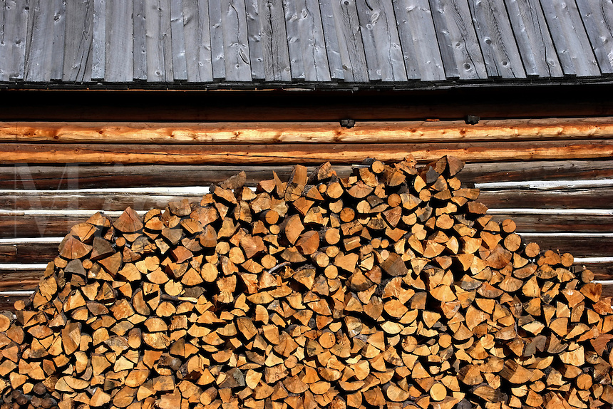 Firewood stacked against a historic barn in Jackson Hole at the Triangle X Ranch in Grand Teton National Park.