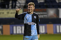 Jason McCarthy of Wycombe Wanderers celebrates victory against Luton Town after the Sky Bet League 2 match between Luton Town and Wycombe Wanderers at Kenilworth Road, Luton, England on 26 December 2015. Photo by David Horn.