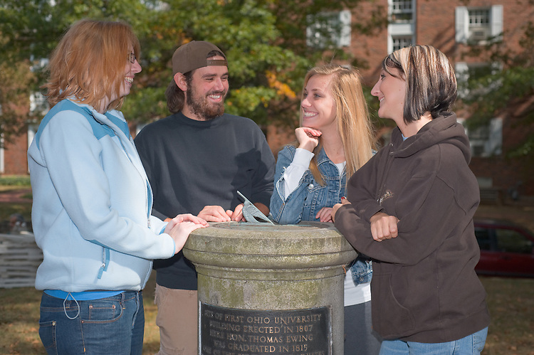 19074Students on Campus Fall..Left to right:...Megan Brown, Kent Weber, Kelsi Boyd, and Kimberly Castor