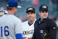 Charlotte Knights manager Julio Vinas (center) meets with Durham Bulls manager Jared Sandberg (16) and home plate umpire John Bacon prior to the International League game at BB&T BallPark on April 14, 2016 in Charlotte, North Carolina.  The Bulls defeated the Knights 2-0.  (Brian Westerholt/Four Seam Images)