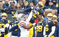 Ohio State Buckeyes cornerback Eli Apple (13) breaks up a pass meant for Michigan Wolverines wide receiver Amara Darboh (82) in the first half at Michigan Stadium on November 28, 2015. (Chris Russell/Dispatch Photo)