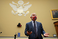 Dr. Anthony Fauci, director of the National Institute for Allergy and Infectious Diseases, arrives to testify before the House Subcommittee on the Coronavirus Crisis during a hearing on a national plan to contain the COVID-19 pandemic, on Capitol Hill in Washington, DC on Friday, July 31, 2020. <br /> Credit: Kevin Dietsch / Pool via CNP /MediaPunch