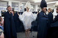 JOHANNESBURG, SOUTH AFRICA - FEBRUARY 19: Fashion models wait backstage before a show with the designer David Tlale, at his studios at the Joburg Fashion Week on February 19, 2011, in Johannesburg, South Africa. David Tlale, is an award winning designer and one of South Africa's finest designers, dressing celebrities and others in couture with elegance and high quality material. He held his show at the Mandela Bridge in downtown Johannesburg. A logistical nightmare, the bridge was closed and turned into a  catwalk at midnight with hundreds of people watching the show.  92 models, one for each of Nelson Mandela's years walked the 285 meter bridge, maybe the longest catwalk in the world. South African top designers with showed their 2011 Autumn & Winter collections during the 5 day event. (Photo by Per-Anders Pettersson)