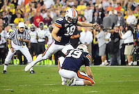 Jan 10, 2011; Glendale, AZ, USA; Auburn Tigers kicker Wes Byrum (18) kicks a field goal from the hold of quarterback Neil Caudle (left) as time expires to defeat the Oregon Ducks 22-19 in the 2011 BCS National Championship game at University of Phoenix Stadium.  Mandatory Credit: Mark J. Rebilas-