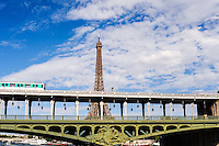 Paris, France. View from a boat on the river Seine. The Eiffel Tower, built in 1889, 320m high. Pont de Bir-Hakeim bridge in the foregorund.