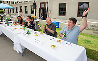 Judges from right: John Lang, associate professor, sociology; Brad Kent, chef; Courtney Robertson, corporate & foundation relations and Venitia Boyce '19.<br /> Six student teams battle to win the Iron Chef competition as part of Earth Month on Thursday, April 11, 2019 in the JSC Quad. Event MC, Amos Himmelstein, provided play-by-play of the action. Their task was to create the best vegetarian or vegan starter and sauté dishes. A wide variety of fresh organic produce (some freshly picked at the FEAST garden), FEAST eggs, spices, oils AND one secret ingredient were at the team's disposal.<br /> Chef Brad Kent, owner of Olio GCM Wood Fired Pizzeria at Grand Central Market and co-Founder/chief culinary officer for Blaze Pizza, is this year's guest judge.<br /> The contest is led by FEAST and supported by Campus Dining, Facilities Management, RESF, and the Office of the President.<br /> (Photo by Marc Campos, Occidental College Photographer)