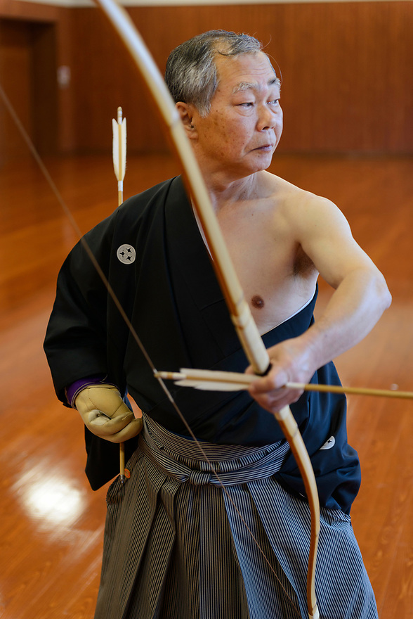 7th-dan Kyodo master Kazuyuki Shigenobu, Kyudo Practice Hall, Miyakonojo, Miyazaki Prefecture, Japan, December 22, 2016. A handful of bowyers from the Kyushu city of Miyakonojo make over 90% of all the bows used in traditional Japanese archery. The bows are made from laminated bamboo and haze wood in process that consists of over 200 individual tasks. At over two meters from tip to tip the bows the longest used in the world.