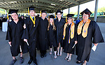 Graduates, from left, Max Greb, Kyle Flanagan, Nicholas Thornhill, Andria Love, Megan Church, Becki West and Michelle Davis-Lange pose before the 2013 Western Nevada College Commencement at the Pony Express Pavilion, in Carson City, Nev., on Monday, May 20, 2013. .Photo by Cathleen Allison