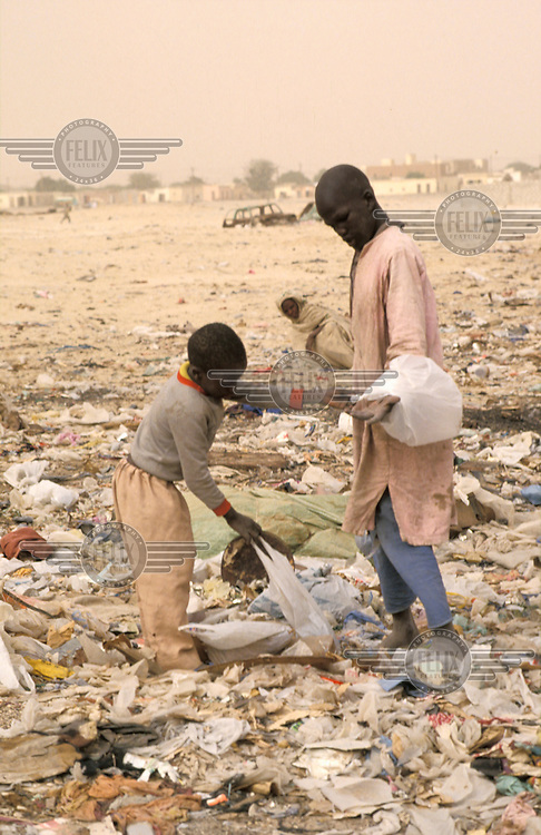 People foraging on a rubbish dump on the outskirts of the capital. Widespread drought has led to rapid urbanisation, and severe poverty.