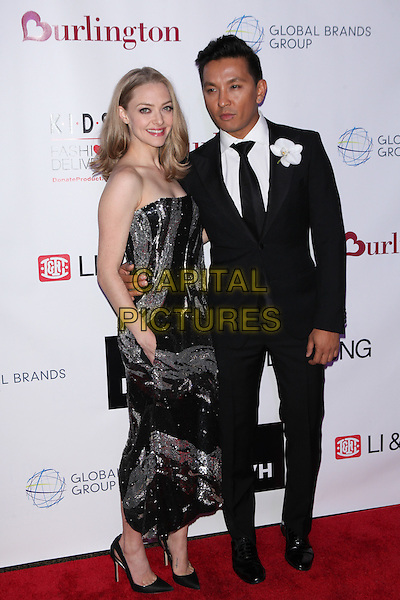 NEW YORK, NY - NOVEMBER 4: Amanda Seyfried  and designer Prabal Gurung  at the K.I.D.S./Fashion Delivers Annual Gala to Honor Stuart M. Brister, Dow Famulak &amp; Shikshya Foundation Nepal at The American Museum of Natural History in New York City 0n November 4, 2015.  <br /> CAP/MPI99<br /> &copy;MPI99/Capital Pictures
