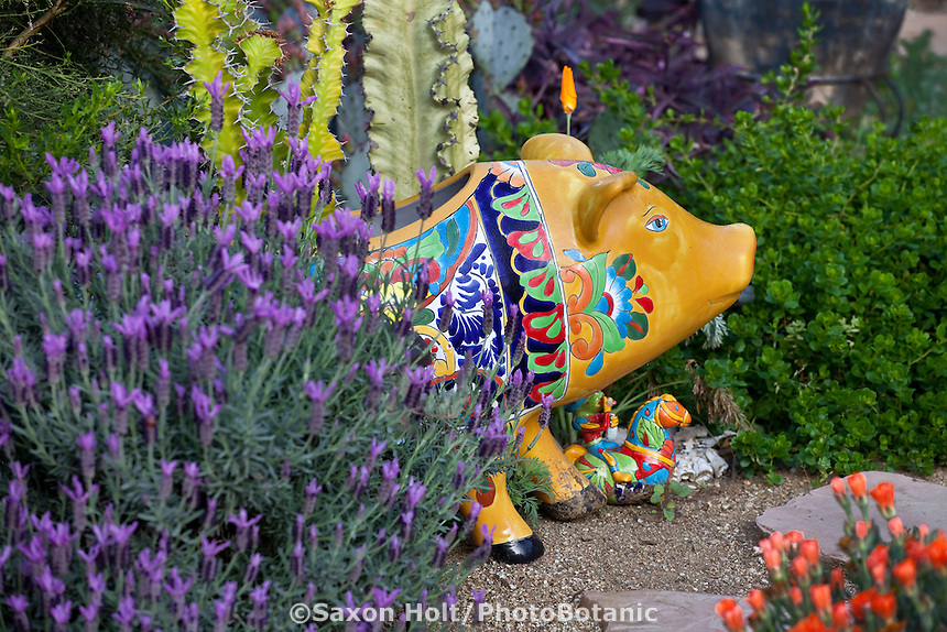 Ceramic pig sculpture in California drought tolerant garden with lavender