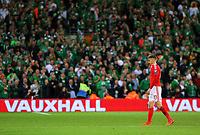 A disappointed Aaron Ramsey of Wales walks infront of the cheering Ireland supporters during the FIFA World Cup Qualifier Group D match between Wales and Republic of Ireland at The Cardiff City Stadium, Wales, UK. Monday 09 October 2017