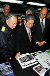 PACIFIC OCEAN (April 4, 2011) Adm. Masahiko Sugimoto, left, chief of staff for the Japan Maritime Self-Defense Force, Japan Defense Minister Toshimi Kitazawa, and United States Ambassador John Roos, look at photographs and intelligence gathered during Operation Tomodachi aboard the aircraft carrier USS Ronald Reagan (CVN 76). During the visit Japanese and American officials thanked Ronald Reagan Sailors for relief efforts during Operation Tomodachi. Ronald Reagan is off the coast of Japan to provide disaster relief and humanitarian assistance to Japan as directed in support of Operation Tomodachi. (Photo by U.S. Navy/AFLO) [0006]