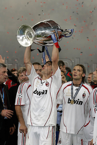 23 May 2007: AC Milan striker Kaka celebrates on the pitch with the trophy after the UEFA Champions League Final between AC Milan and Liverpool played at The Olympic Stadium, Athens, Greece. Milan won the game 2-1 Photo: Neil TingleActionplus....070523 player soccer football joy winner celebration celebrate.